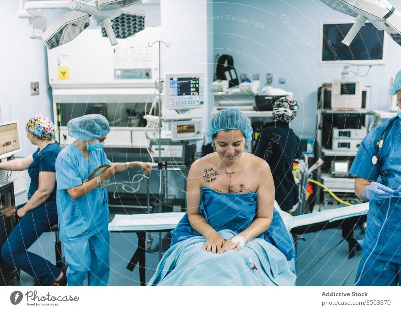 Surgeon taking picture of patient breast surgeon take photo hospital mammoplasty woman professional medicine nude clinic device gadget doctor job work female