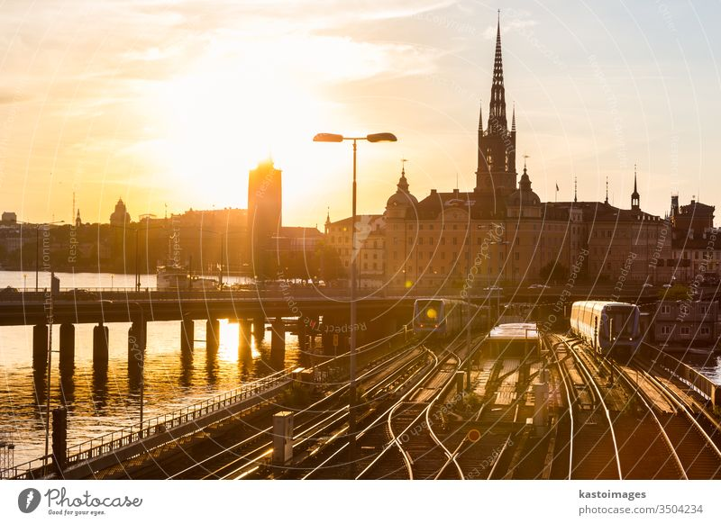 Railway tracks and trains in Stockholm, Sweden. railway railroad transport outdoor old travel tourism sweden europe town city skyline cityscape sunset