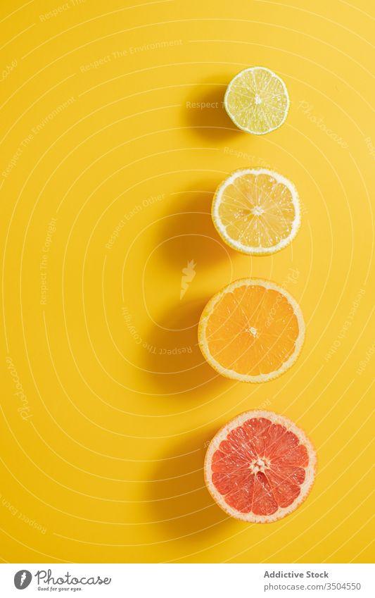 Cut citruses composition on lumber table half vitamin c line concept ripe assorted black colorful fruit fresh healthy organic natural juice lime lemon orange