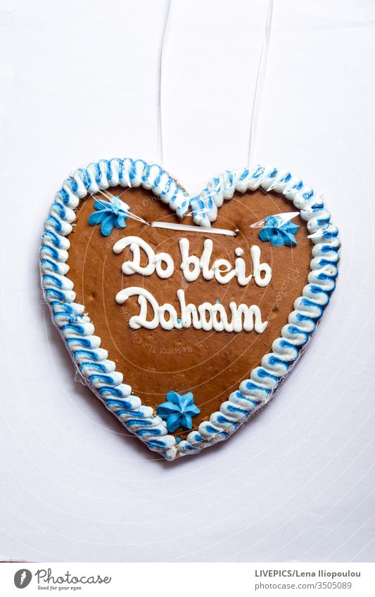 "Gingerbread heart with the note ""stay home"" dahoam gingerbread heart stay at home Quarantine Corona virus pandemic prevention Virus coronavirus flu covid-19"
