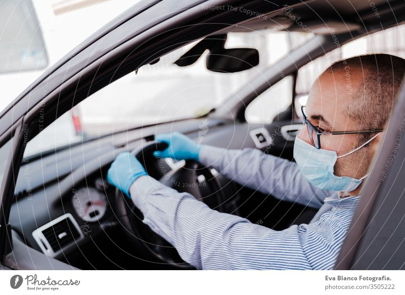 man driving a car wearing protective mask and gloves during pandemic coronacirus covid-19 coronavirus protective gloves infect automobile health transport air