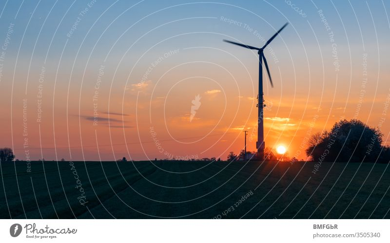 silhouette pinwheel at sunrise agriculture alternative change clean climate change construction development earth ecological ecology electric electrical
