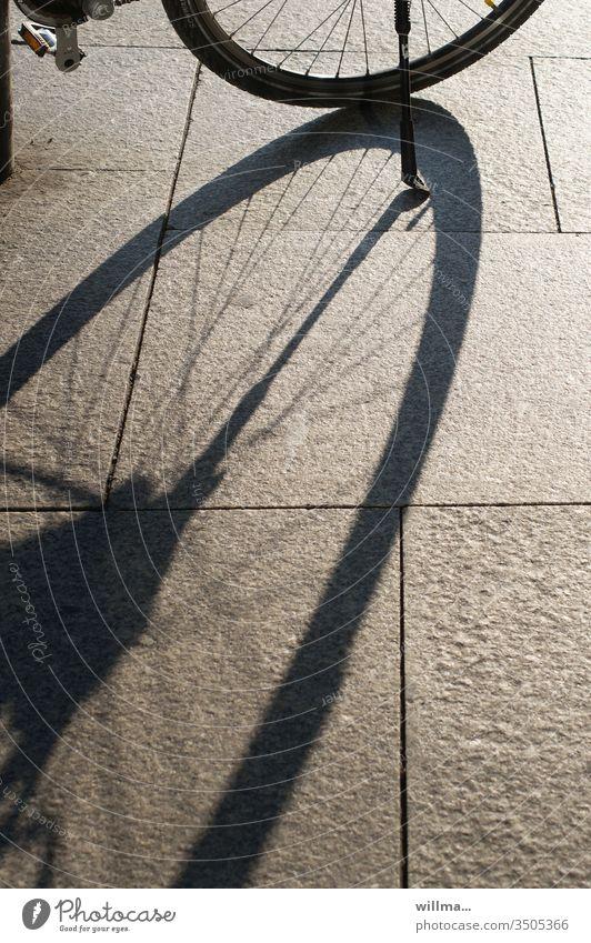 My boner casts very long shadows Shadow Wheel Bicycle Spokes Stone slab sunny Bicycle rack pennant
