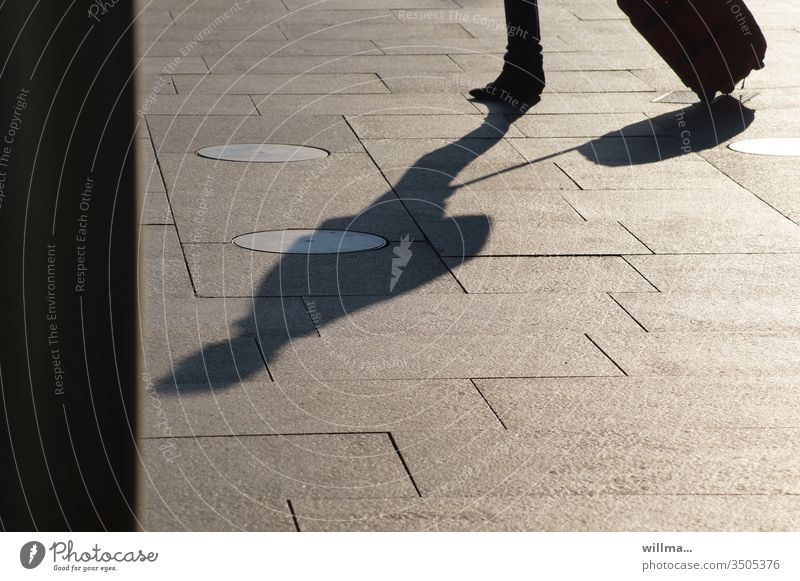 Shadow of a traveller with a wheeled suitcase go away Vacation & Travel trolley Human being Wait Suitcase Luggage Tourist voyager
