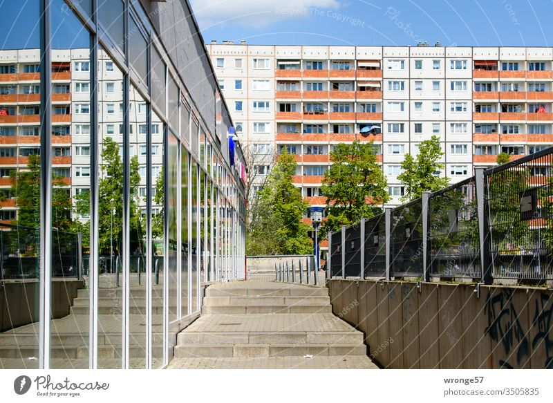 Magdeburger Plattenbau and its reflection in a glass facade Prefab construction Apartment Building Facade roadside Window Balconies reflections Glas facade off
