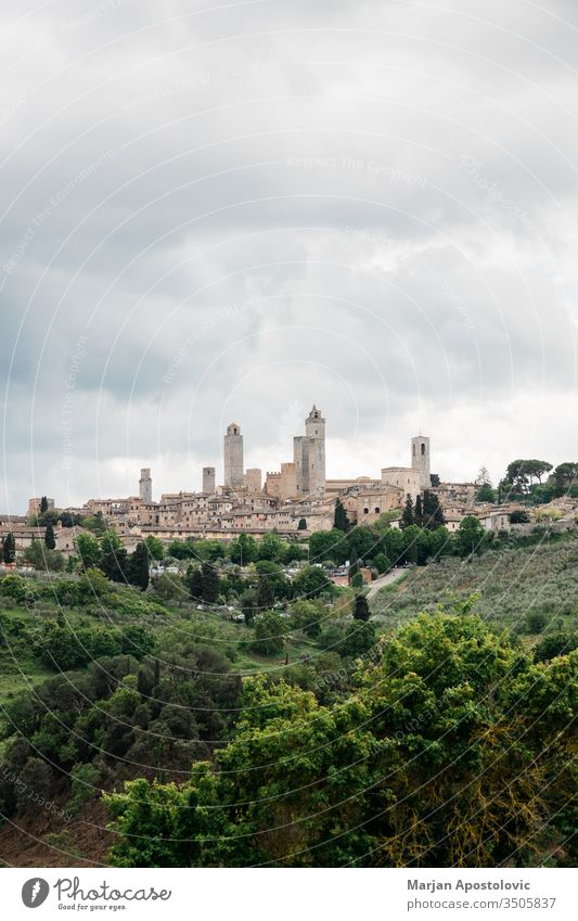 Stormy weather over high towers of San Gimignano, Tuscany, Italy ancient architecture attraction building castle cathedral church city cityscape clouds cloudy
