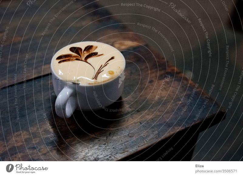 Egg coffee, a Vietnamese speciality, on a wooden table in a café Egg Coffee Speciality latte type Flowerpot Table Cup Café Delicious Caffeine Characteristic