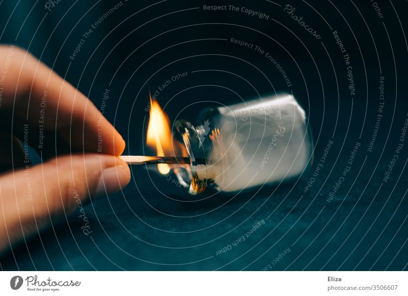 A hand experimenting with a burning match and holding it in an apothecary's flask, in which smoke then forms Match Flame Phial Hand stop Burn Fire Experimental