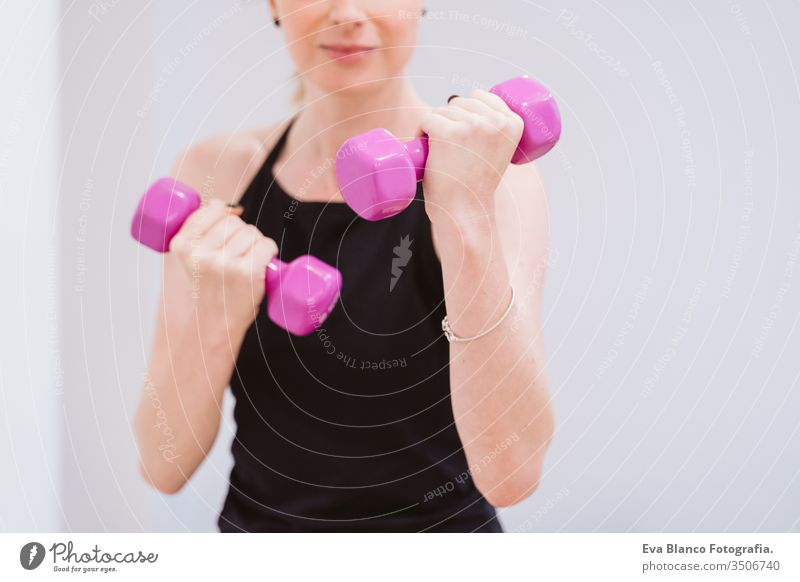 group of women practicing sport at the gym with dumbbells. Healthy lifestyle friends healthy indoors fitness training heavy care push press-ups girl male