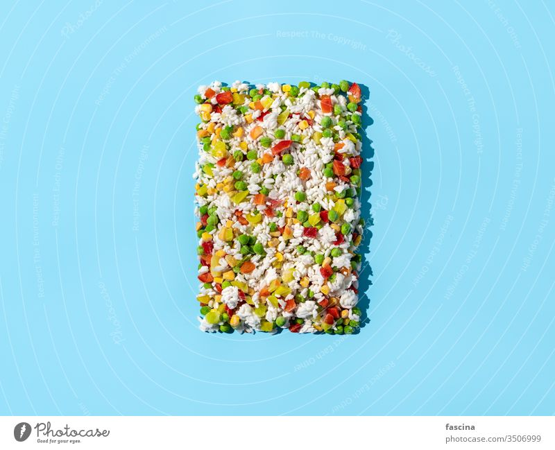 Frozen vegetables assorted on blue, top view frozen vegetables frozen food ice mix background isolated hawaii mix agriculture closeup cold cooking copy