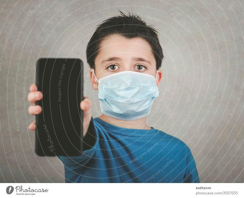 kid wearing medical mask with smartphone coronavirus child 2019-ncov epidemic covid-19 pandemic quarantine symptom medicine digital computer communication