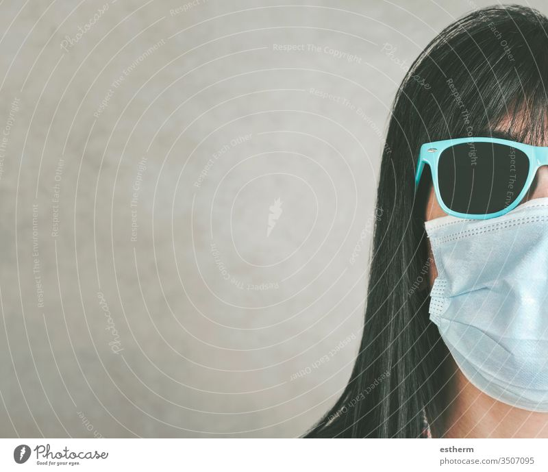 woman wearing medical mask for coronavirus with sunglasses young woman covid-19 virus epidemic pandemic quarantine cool summer lifestyle sign sad sadness