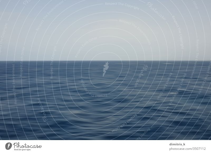 Deep sea waves and blue sky. Abstract motion blur background. horizon deep seascape abstract ripples water nature clear minimal simple sparse surface flow