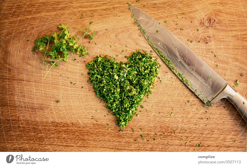 Herbs love | cut parsley in heart shape Parsley heart-shaped Heart Love vegan Vegan diet Herbs and spices Knives Chopping board cutting knife Wooden table
