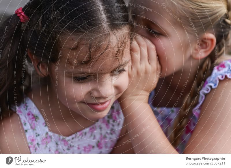 Two sisters play games mystery Mysterious Smiley happy Sister Friends Summer Dress children girls playtime