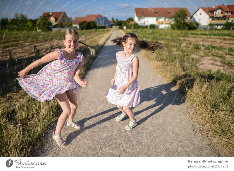 Two sisters play games buzzer Sun jumpin Dance Smiley happy Shadow Field Village girls Dress