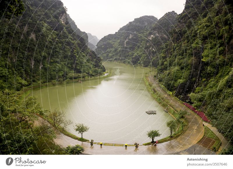 Lake Tuyet Tinh Coc near Ninh Binh, Vietnam Nature Landscape mountains Steep Green Water off circular trail Valley Asia Exterior shot Vacation & Travel Culture
