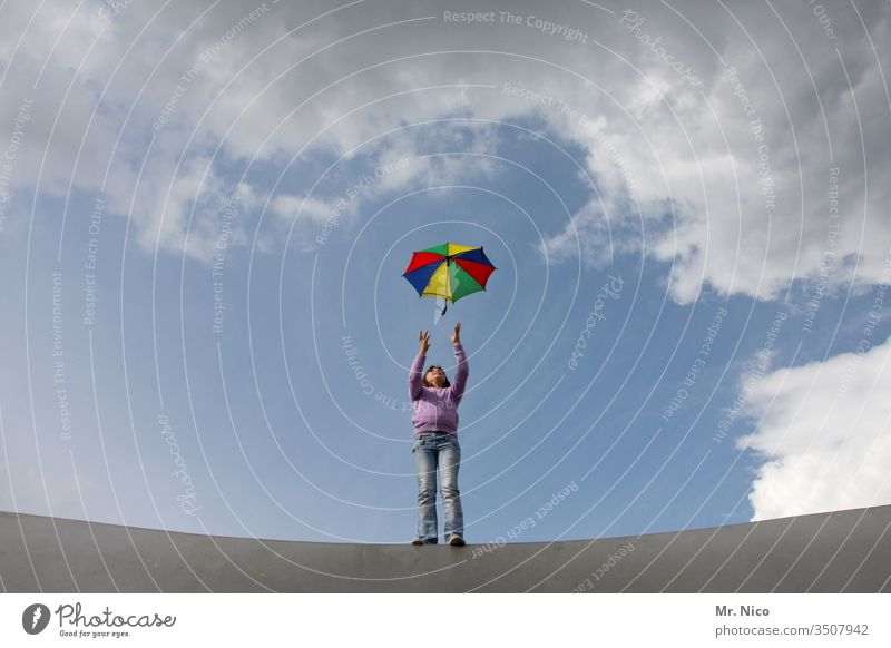 umbrella Umbrella Throw Catch variegated Prismatic colors Sky Clouds Playing Leisure and hobbies Movement Freedom Self-confident Cool (slang) Gale Wind