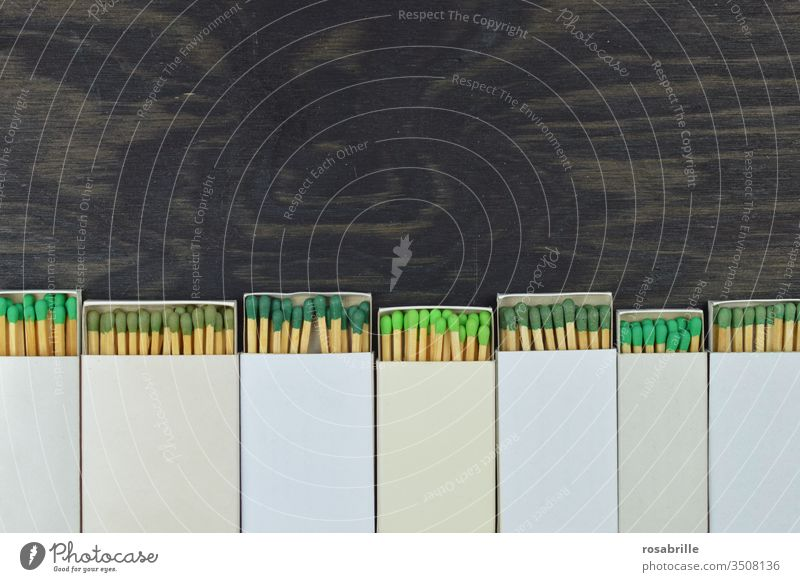 Matches with green heads looking out of opened matchboxes | colour combination matches Green Head Ignite Fire Collection open space colored White Mixed Round