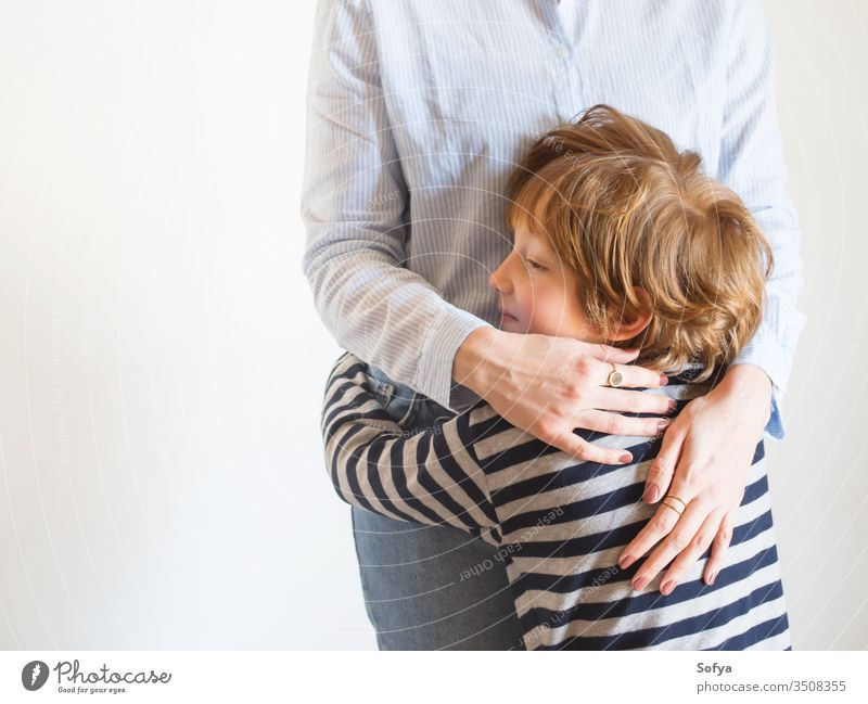 Young mother and child hugging. Mothers day mom parent mothers day woman faceless lifestyle kid love son together family emotion feelings eyes caucasian happy