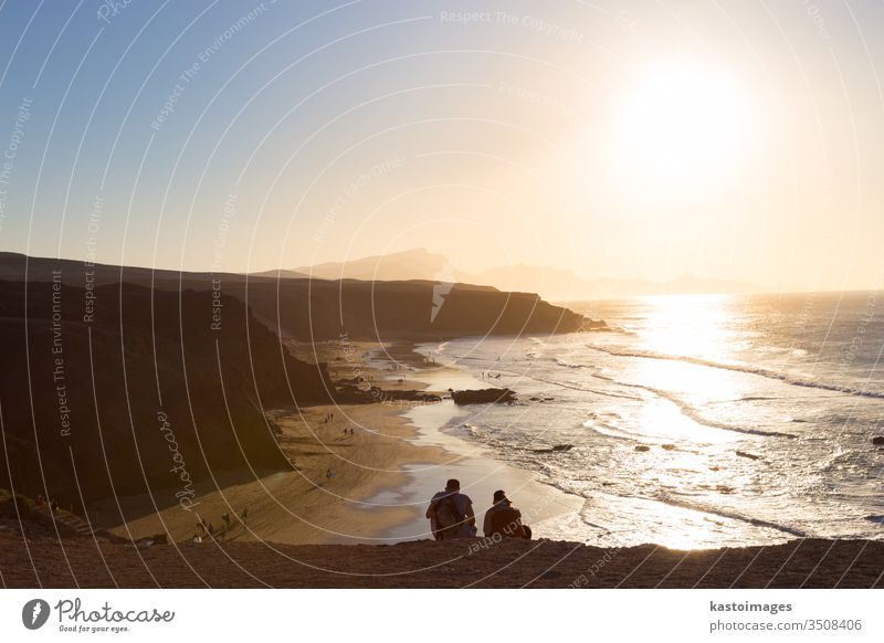 Pared beach, Fuerteventura, Canary Islands, Spain La Pared couple romantic view landscape sunset water nature sea ocean travel background surf wave sand summer