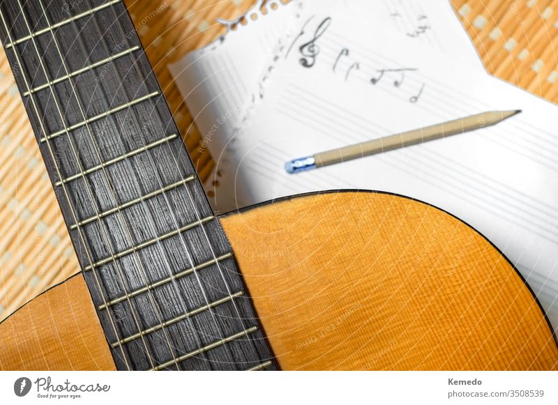 Top view of a classical guitar, music notebook with stave and pencil. Concept of composing or studying music. compose musical staff guitarist musician