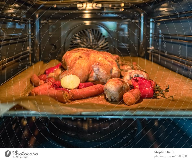 appetizing roast turkey with vegetables in the oven. chicken cook grill thanksgiving food baked cooked cooking dinner meal poultry roasted barbecue bbq hot bird