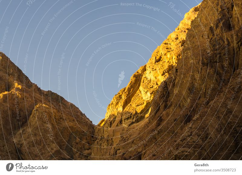 high mountains against the blue sky in Egypt Dahab South Sinai background bright color contrast day exotic height high rocks landscape mountain landscape