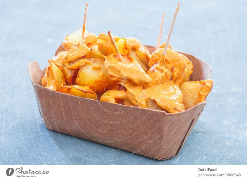 Patatas bravas traditional Spanish take away background baked bar chips closeup cuisine dish food fried garlic home horizontal ketchup mayonnaise mediterranean