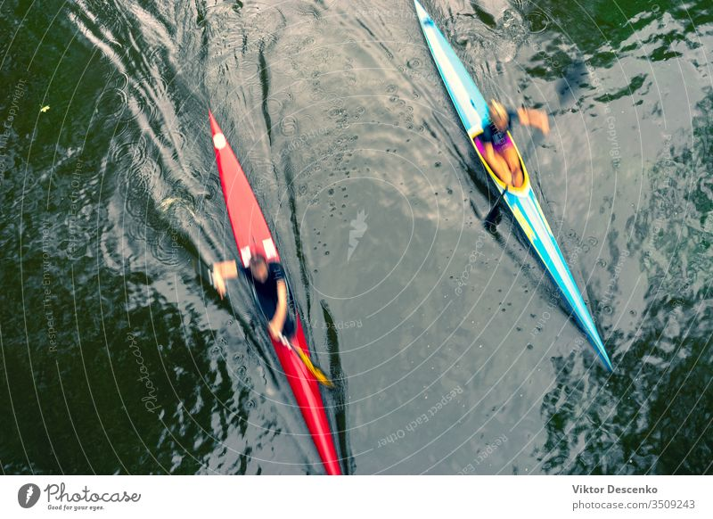 Two kayaks on the water with reflection background woman beach person sport fitness summer nature face sun active competition kayaking speed air fun lifestyle