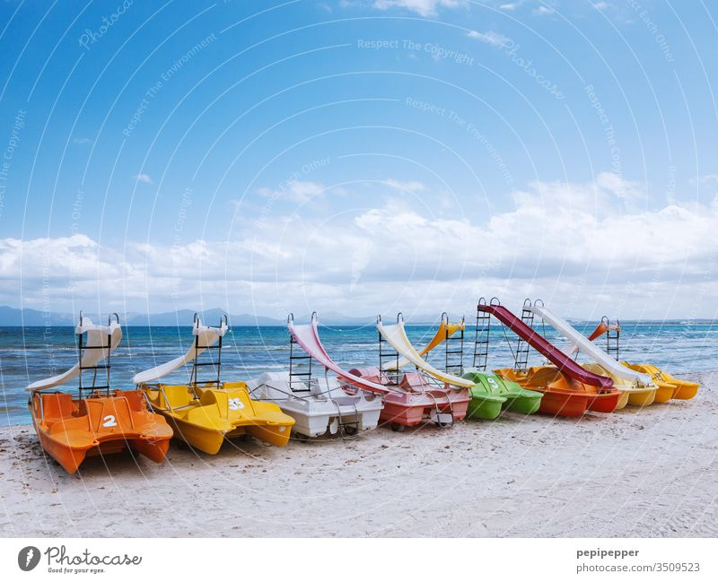 colourful pedal boats lying on the beach of Mallorca variegated Colour photo Exterior shot Multicoloured Red Day Orange green Yellow Deserted Blue Pedalo motley