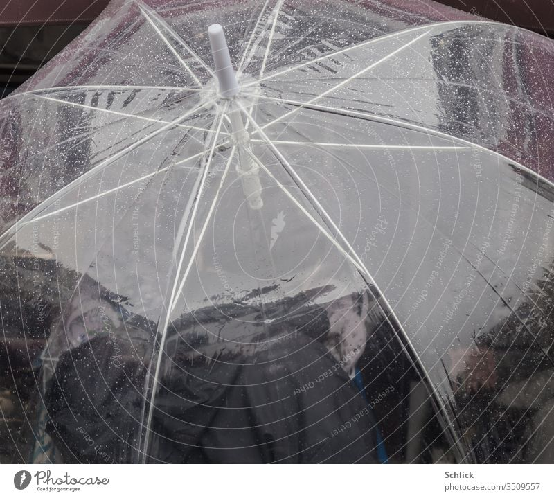 Transparent umbrella with raindrops photographed from above Umbrella transparent Drops of water Human being person Polyurethane Plastic Packing film