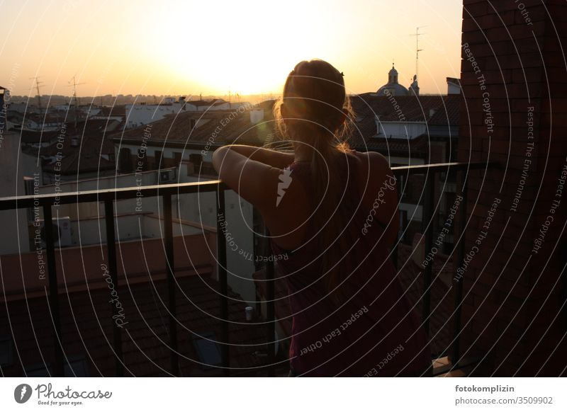 young woman gazing over city roofs in the evening sun Evening sun Balcony Town City cityscape Meditative melancholy contemplating Back-light urban