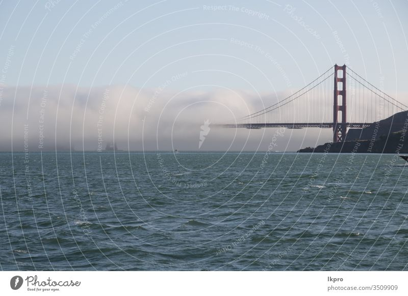 san francisco the famous  golden bridge symbol metropolis district destinations foggy coast cloud tourist light dusk historic golden gate bridge engineering