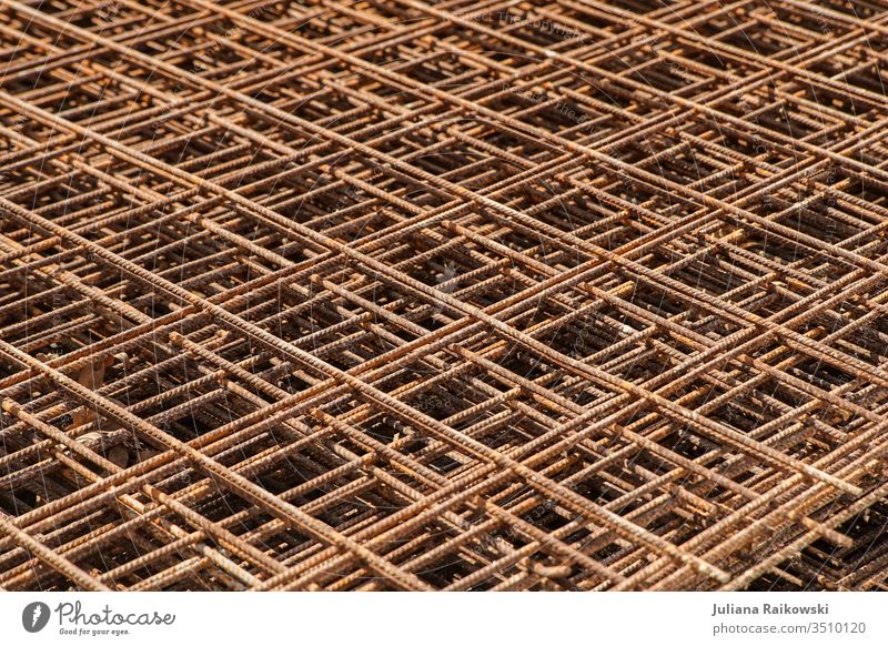 Grid on a construction site Grating Architecture built Manmade structures Construction site Exterior shot Wall (barrier) Town Change Build Work and employment
