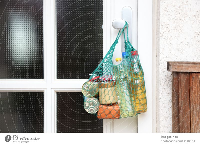 Delivery of food in the shopping net during the coronavirus infection Covid-19 quarantine. Shopping bag, net bag with shopping, goods, food hanging on the front door, neighbourhood help. Help for vulnerable people Concept