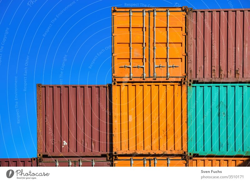 Several ship containers against a blue background Container Shipping container cargo Transport commodities Cargo shank Industry Harbour export Dock Navigation