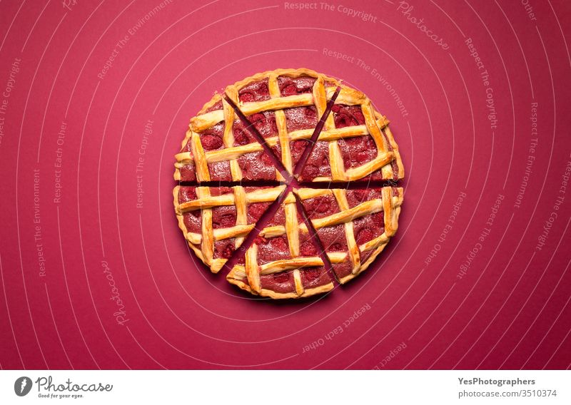 Sliced raspberry pie with a lattice crust. Tasty classic dessert american baked bakery berries cake decoration delicious divided equal fine dining flat lay food