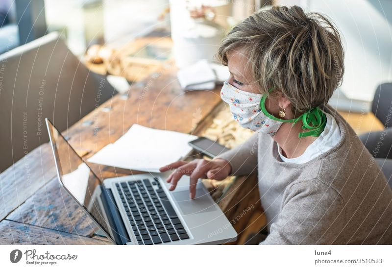Woman with mouth guard working on laptop Mask Home Office labour at home room House (Residential Structure) Blonde Calculator Computer Quarantine technology