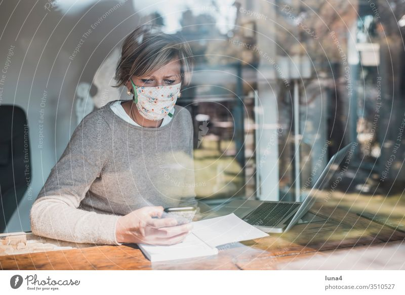 Woman with face mask and smartphone Mask Home Office labour laptop Telephone mobile at home room House (Residential Structure) Blonde Calculator Computer