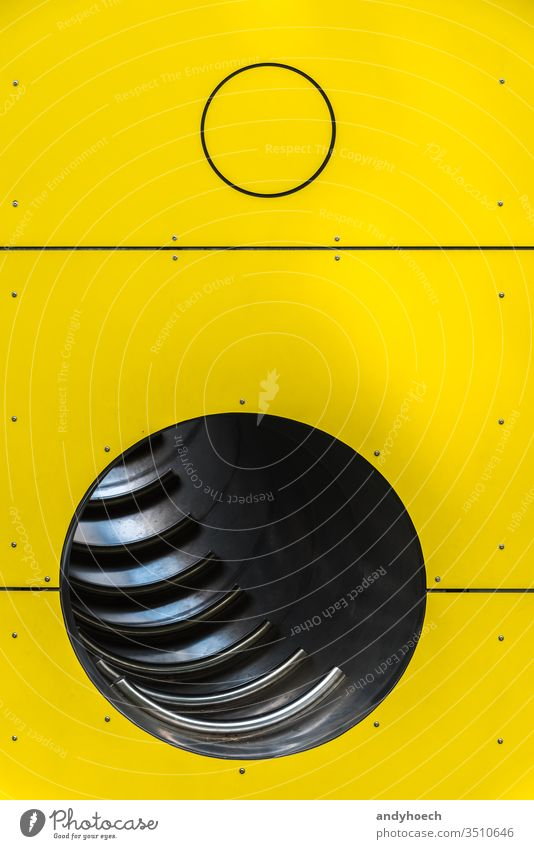 The steel pipes behind a yellow wall abstract architecture Background backgrounds built structure ceiling circle colored copy space creative creativity day