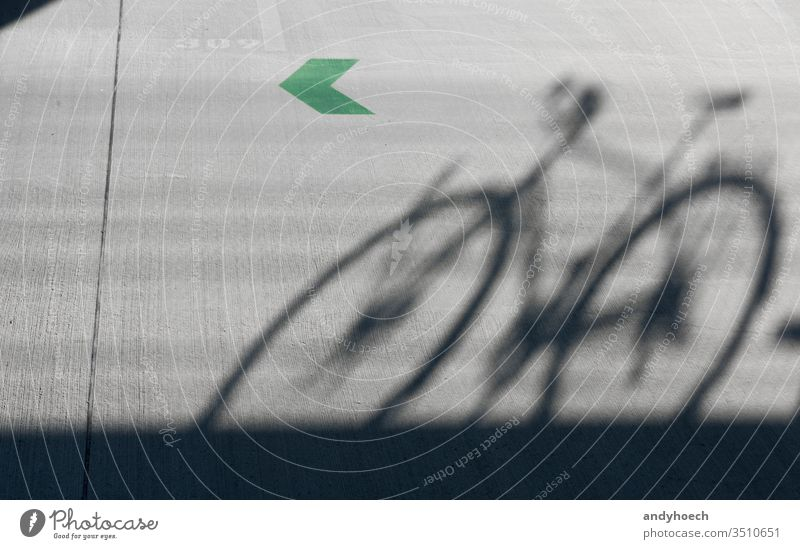 A shadow of a road bike with a green arrow 309 abstract architecture Background bicycle Bike biking black city color communication concept concrete copy space