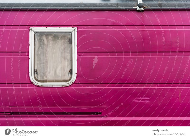 A window in a purple old camper alternative around the world Background backgrounds camping campsite caravan closed color colored copy space curtain day design