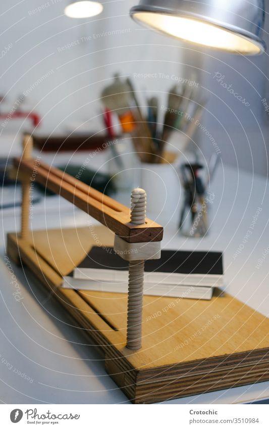 Vertical photo of a wooden hand press in a bookbinding shop vertical handcraft handmade paper printing equipment artistic books creativity employee expertise