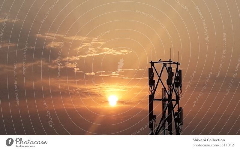 Telecommunication tower in India at the beautiful morning sunrise moments Antenna background Beautiful scenery Blue broadcast Broadcasting station