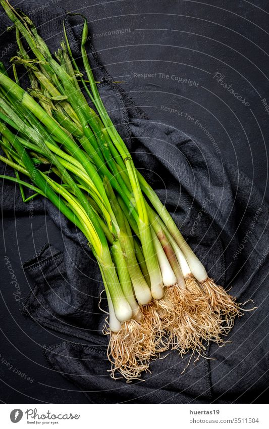 Fresh red and white onions on dark background food vegetable ingredient natural healthy food fresh vegetarian vegan organic group raw plant nutrition bulb green