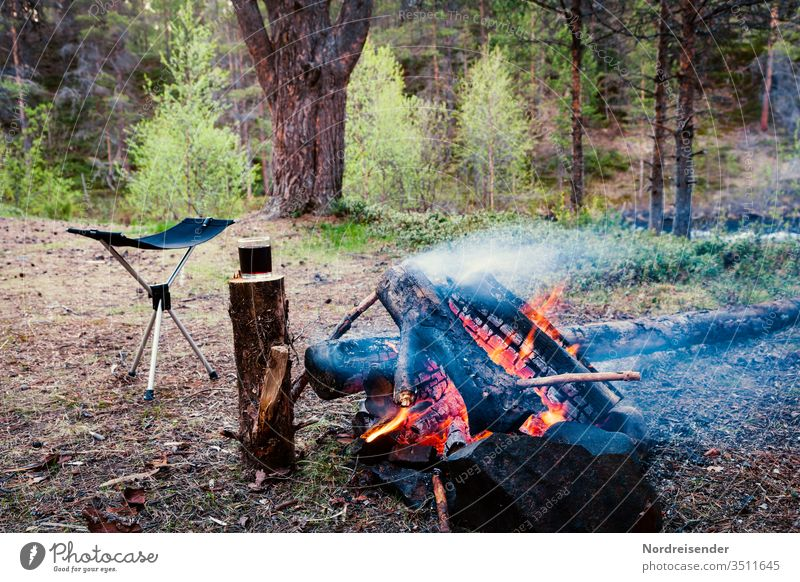 A glass of red wine always goes Red wine campfire Camping Vine Forest Wilderness Chair camping furniture wood Fire Firewood Freedom Adventure time-out