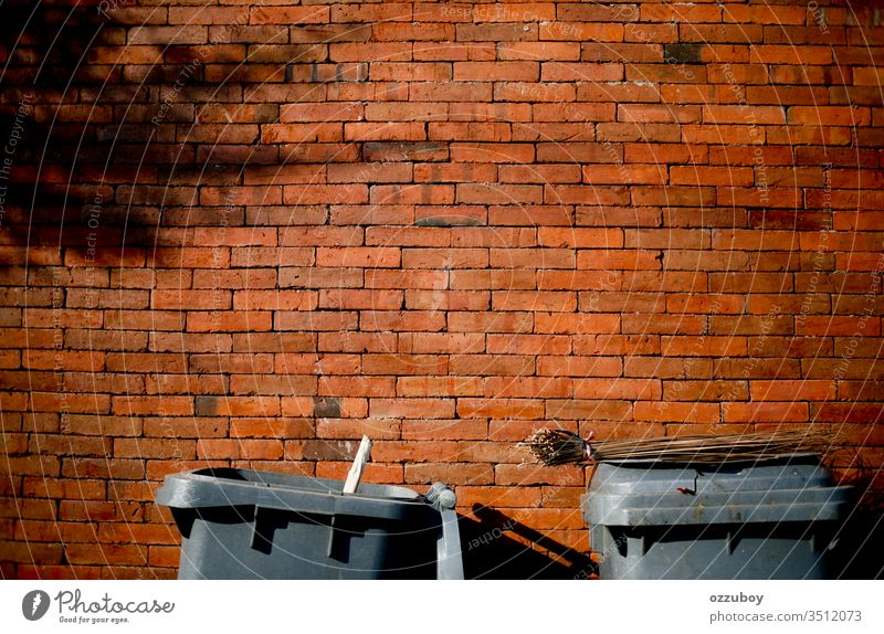 close up garbage bin with copy space Wall (building) Brick Brick wall Copy Space Yellow Red Garbage dump garbage can Trash container Shadow simplicity