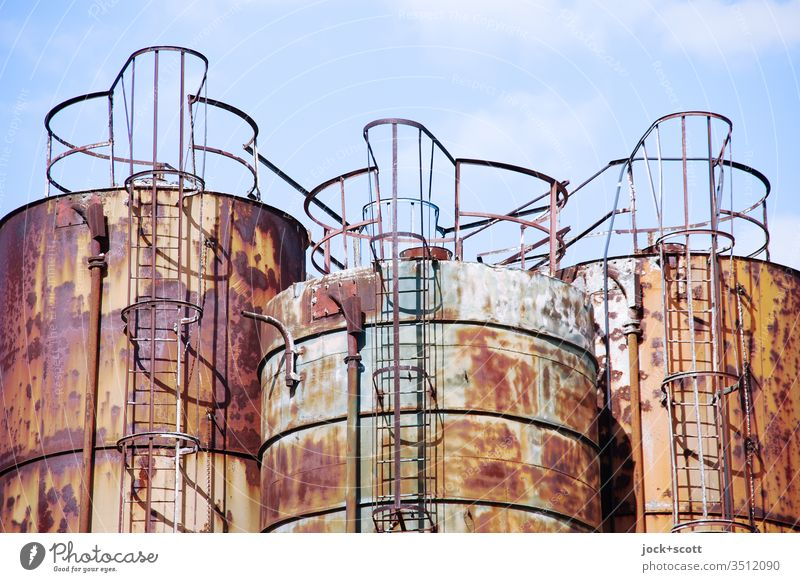 Triad of iron, oxygen and water Silo Metal Rust three Old Industry Industrial Photography Sky Sunlight Neutral Background Agreed Warmth great Change Symmetry