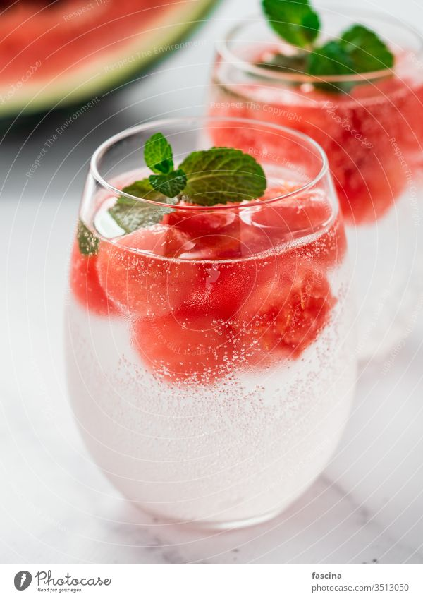 Watermelon ice with sparkling water in glasses ball watermelon fruit beverage summer dessert fresh cold red cool gourmet background sweet juice frozen juicy bar